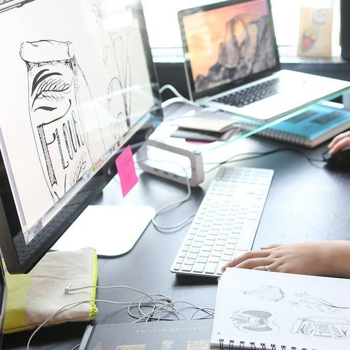 Design and hand-drawn sketches on a computer screen